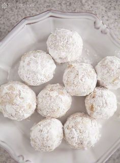 Festive holiday cookies made from a mixture of finely chopped walnuts, flour and vanilla, rolled into little balls and dusted with powdered sugar. ~ SimplyRecipes.com