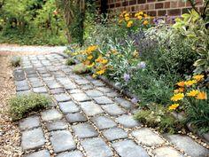 Taller Edging Bricks Help Contain Bedding Plants