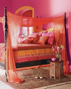 love these colors. not too crazy about how low the canopy is to the bed though