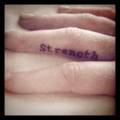 strength finger tattoo