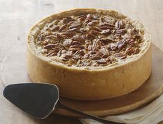 Deep dish pecan pie, Southern Living, 2000.  Made this many years ago with a sprinkle of bittersweet chocolate chips in it (and wrapped a wide ribbon around it for a Christmas dinner.)  Delicious!