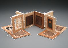 """Philosophy of Life Statement; Book and Box by Theresa Marr.   4"""" x 4"""" x 3.5"""" (box) 12"""" x 16"""" x .25"""" (book opened flat) Copper, Thread, Handmade Abaca Lace Paper, Veneer, Binders Board, Hand Marbled Paper, Fabric 2009"""