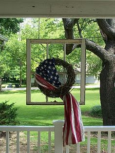 DIY:  Salvaged window hung from the ceiling.  Love the wreath & flag - creative & patriotic.