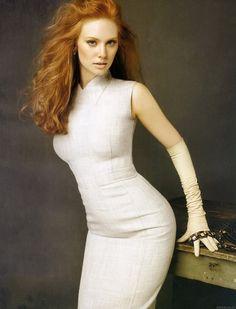 Deborah Ann Woll curves in a white sleeveless dress