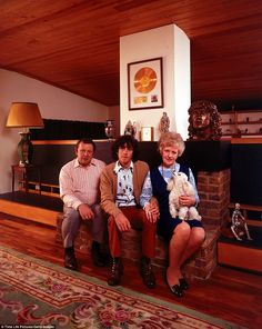 Proud of his success: Folk rock musician Donovan sits with his parents Donald and Winifred Leitch in their home in England.    LIFE Magazine photographer John Olson followed some of these big name stars home to see their parents to tell the inside story of the private lives of famous musicians and show their person histories.