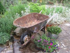 <3 wheelbarrow garden, wheelbarrow planter, plants, flea market gardening, gardens, plant containers, rusti wheelbarrow, flower, planting a garden