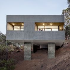 A combined car park and terrace covers the roof of this hillside house in Los Angeles.