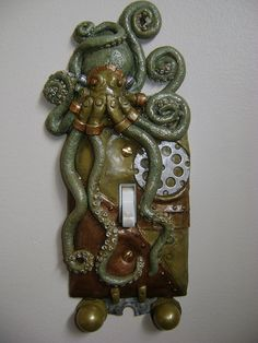Green, Hand Made, SteamPunk, Octopus, Light Switch Cover with key chain holders. $20.00, via Etsy.
