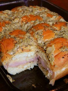Hawaiian Baked Ham and Swiss Sandwiches ~ 1 12 pack of King's Hawaiian Original Rolls 1 lb. deli ham, shaved 1 lb. Swiss cheese, thinly sliced 1 1/2 sticks butter 3 tablespoons Dijon mustard 1 1/2 teaspoons Worcestershire sauce 3 teaspoons of poppy seeds  1 onion, chopped