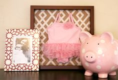 Frame baby clothing as wall art. We love personal touches in the #nursery