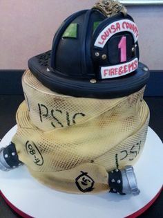 Fire helmet and hose stack cake | Shared by LION