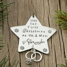 "A beautifully personalized Christmas ornament hand stamped with ""Our First Christmas Together"" and adorned with a double wedding ring charm. Ornament hangs from a whimsical hand-formed swirled wire hanger and makes a great gift idea for winter wedding newlyweds. $29.00 http://www.wholesouljewelry.com/mr-mrs-our-first-christmas-personalized-star-ornament/"
