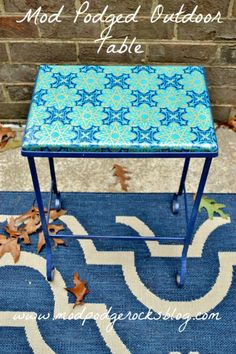 Mod Podged outdoor tabletop made with wrapping paper!