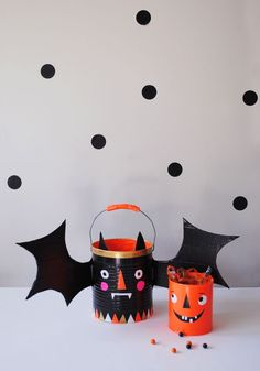 halloween decorations, duct tape, halloween crafts, bucket, tin cans