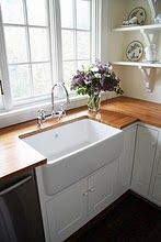 farmhouse apron sink, wood counter tops, open shelving