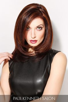Reflective mocha and auburn hues brilliantly build in motion throughout voluminous strands that cradle this model's alluring features.