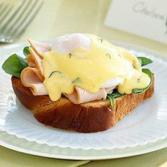 Eggs Benedict gets a makeover with this turkey-spinach version. More brunch recipes: http://www.midwestliving.com/food/breakfast/best-brunch-recipes/page/23/0