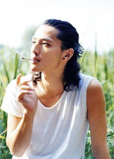 Masanabu Ando smoking a cigarette (or weed)