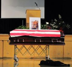 ROCKFORD, Iowa — A fallen Navy SEAL's Labrador retriever proved his loyalty this week when he walked up to his master's casket and lay down, refusing to leave his side.    Navy SEAL Jon Tumilson, 35, a San Diego resident, was among 30 American troops and 22 fellow SEALs killed when a Chinook helicopter was shot down in Afghanistan on August 6.    During his funeral in his hometown of Rockford, Iowa this week, Tumilson's dog, 'Hawkeye,' walked up to the casket, heaved a sigh and dropped down a...