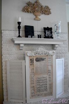 Old Shutters turned Fireplace Screen; painted brick