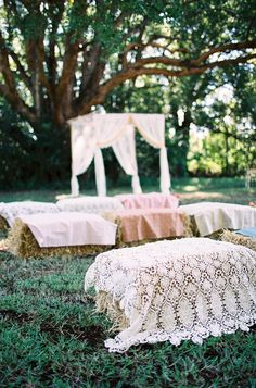 altar with hay bales and vintage linens