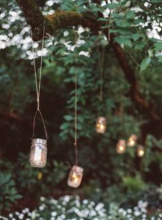 mason jar candles hanging, idea, candle jars in trees, candlelit wedding, backyard parties