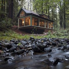 Cabin with creek view and amazing interiors. This is where I want to live...
