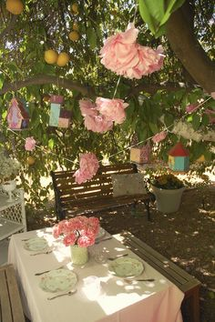 Pink Pom pom garland and hanging birdhouses.