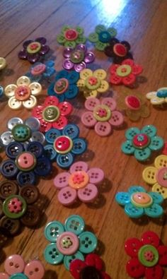Flower-button pins for Girl Scout SWAPs.