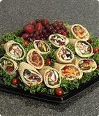 Specialty Wrapped Sandwich Platter (D37) Extraordinary fillings rolled in delicious flat bread bring a new dimension to party sandwiches.  Garnished with grape tomatoes and fresh fruit. Choose up to three fillings, which will be split equally among the sandwiches.