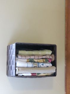A little basket on the kitchen wall for hand towels, to free up drawer space.