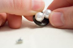 Use buttons to keep pairs of earrings together for storage and travel. Genius!