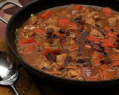 This looks like a perfect fall dinner! // A colorful fall stew with chicken, sweet potatoes and carrots cooked in an apple cider broth. Text, photograph, recipe for Chicken Cider Stew © Kitchen Parade.