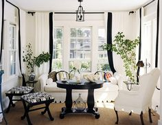 Design Chic: Taking the Edge Off  ** love the drama created by the black but the softening of the look in combining the colours for the curtain.  Really interesting and bold!