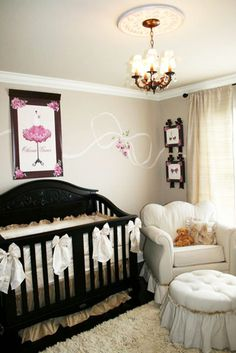 A #pink #Parisian theme pops in an otherwise #neutral colored #nursery.