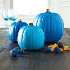 Monochromatic Pumpkins - Transform your porch or home into a monochromatic pumpkin patch. Pick your favorite color and paint each pumpkin with a different tint or tone for an update look for fall and Halloween