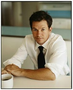 mark wahlberg. Rolled up sleeves. Casual pose