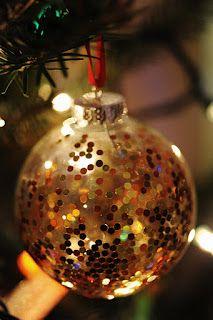Clear glass balls + glitter + ribbon