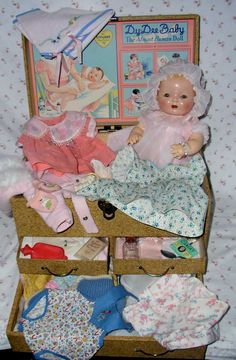 Vintage Effanbee Dy-Dee doll in trunk with complete layette.