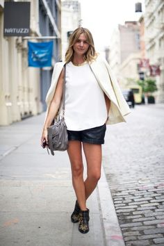 Roxanne Marie lightens up things with a super chic, off-white blazer and baggy leather shorts.
