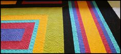 Sprockit, circles, swirls, loops on modern quilt by Carla Barrett using both freehand and digitized quilting