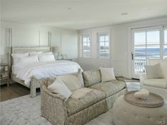 A chic and contemporary all white bedroom with views of the Long Island Sound. Westport, CT Coldwell Banker Residential Brokerage $8,250,000