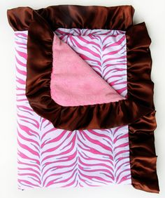 All Diaper Cakes - Zebra Print Satin Trim Blanket, $48.00 (http://alldiapercakes.com/zebra-print-satin-trim-blanket/)