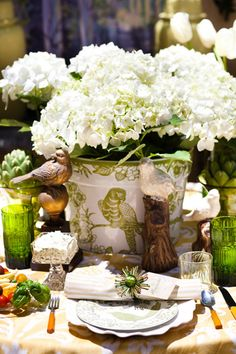 white hydrangea in green and white flower pot, table setting