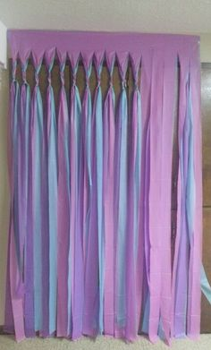 create your own party back drop / wall cover ~ 3 different color cheap plastic table cloths, cut slits and braid top end really like this!
