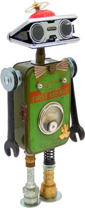 Stanley Steampunk.  Principal Components: Boy Scout first aid tin, opera glasses, clock gear, wrenches, alarm clock bell, amp meter, hydraulic fittings, valve spring