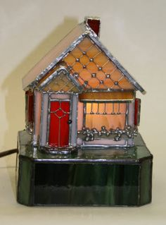 Cute Stained glass mouse house. Christmas village of stained glass??