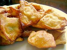 Recipe for Crab Rangoon: 1 brick cream cheese 1 tablespoon onion powder 1 tablespoon garlic powder 1 bunch green onions sliced 1 1/2 cups imitation crab meat, chopped pinch of kosher salt 1 tablespoon white sugar 1 pkg wonton wrapper squares 1 egg, for egg wash Combine all the ingredients except wrappers and egg.