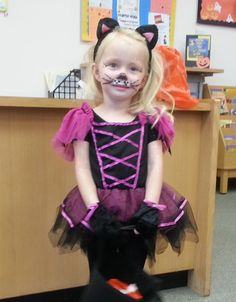 This winsome miss meeowed pleasingly as she visited the Library yesterday, gathering candy from our service desks.