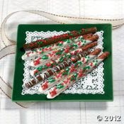 Chocolate-Covered Pretzel Rods. This delicious candy assortment includes 10 pretzel rods with dark chocolate and 5 with white chocolate. Each individually wrapped rod is decorated with tree-shaped sprinkles, nuts or mini candies.